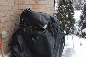 bbq cover wrapped with bungee cord