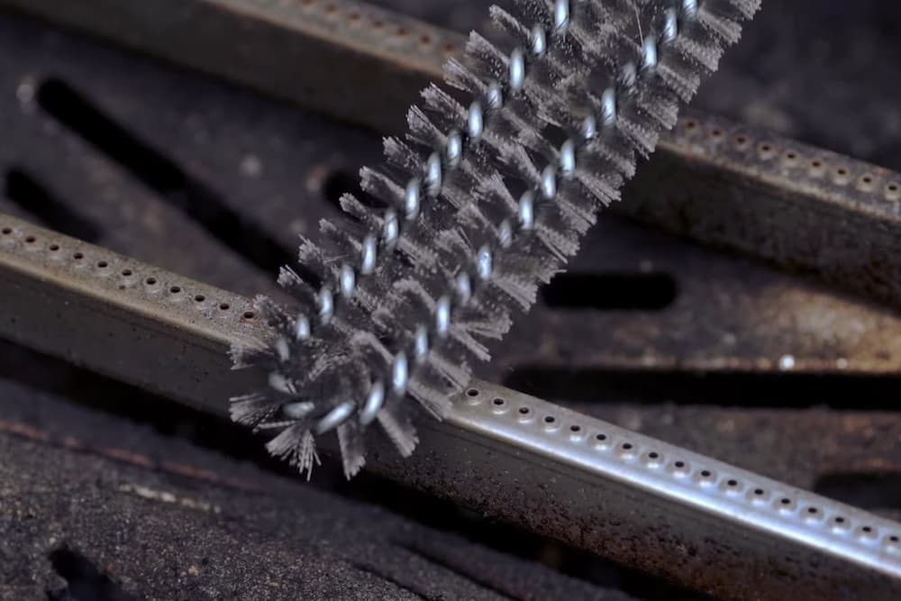 cleaning gas grill burner tube with bristle brush