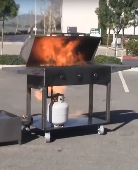 flaming burning gas grill
