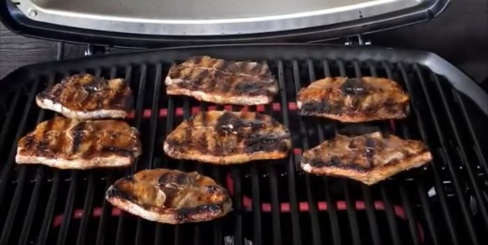 grilling-meat-on-weber q2400 electric grill