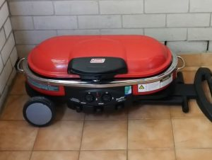 storing coleman roadtrip gas grill in the corner