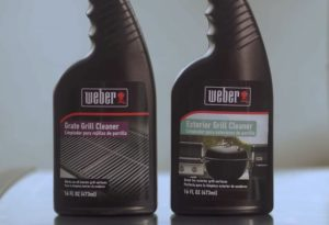 two spray bottles of Weber grill cleaning liquids